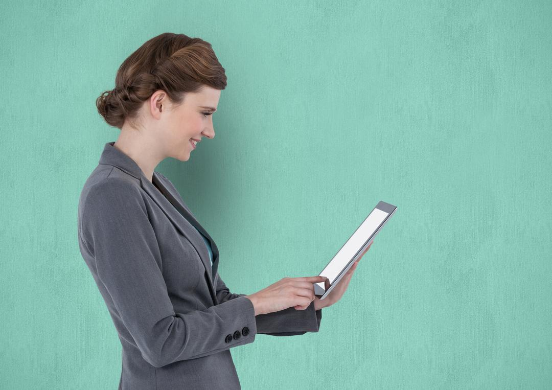 Digital composite of Side view of businesswoman using tablet PC with blank screen