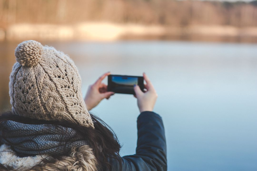 Image of a Woman Taking a Picture of the view with Her Smartphone