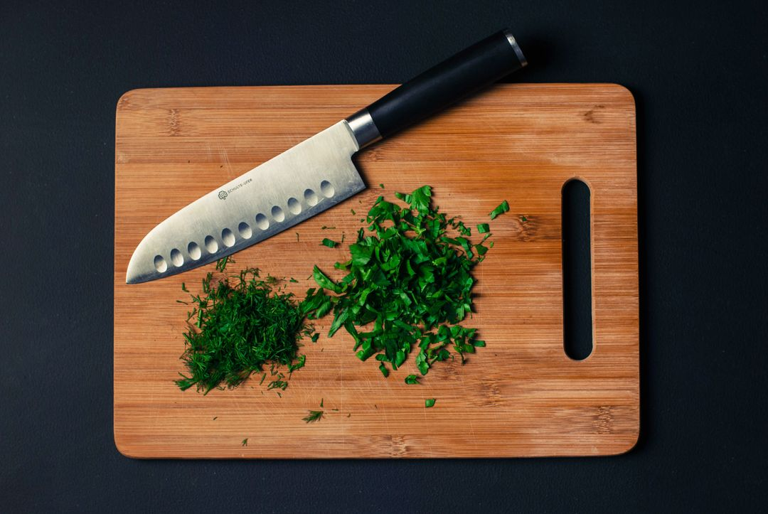 How To Start A Food Blog - chopping board knife herbs