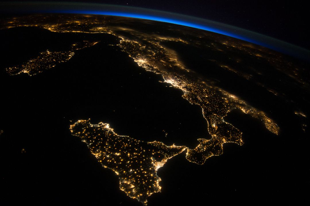 ISS040-E-080962 (26 July 2014) --- One of the Expedition 40 crew members aboard the International Space Station photographed this oblique night image of almost the entire countries of Italy and Sicily on July 26, 2014.