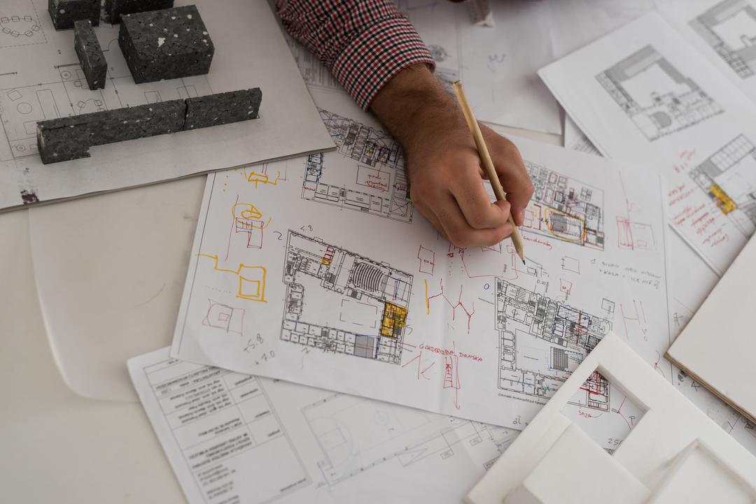 Close-up of male architect working in the office