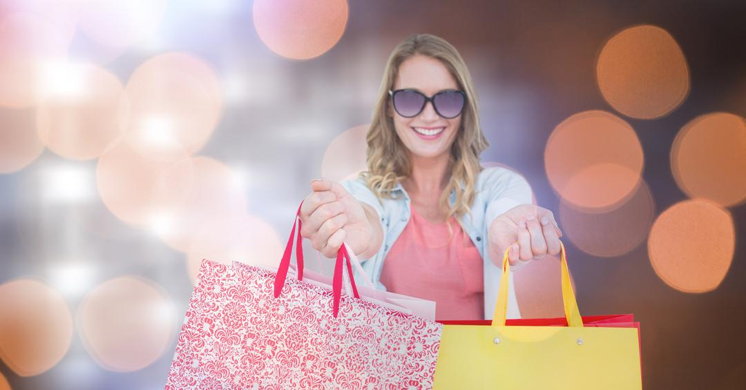 Digital composite of Smiling woman holding shopping bags