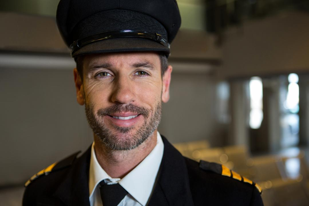 Portrait of smiling pilot at the airport terminal