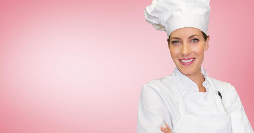 Portrait of female chef standing with arms crossed against pink background Free Stock Images from PikWizard