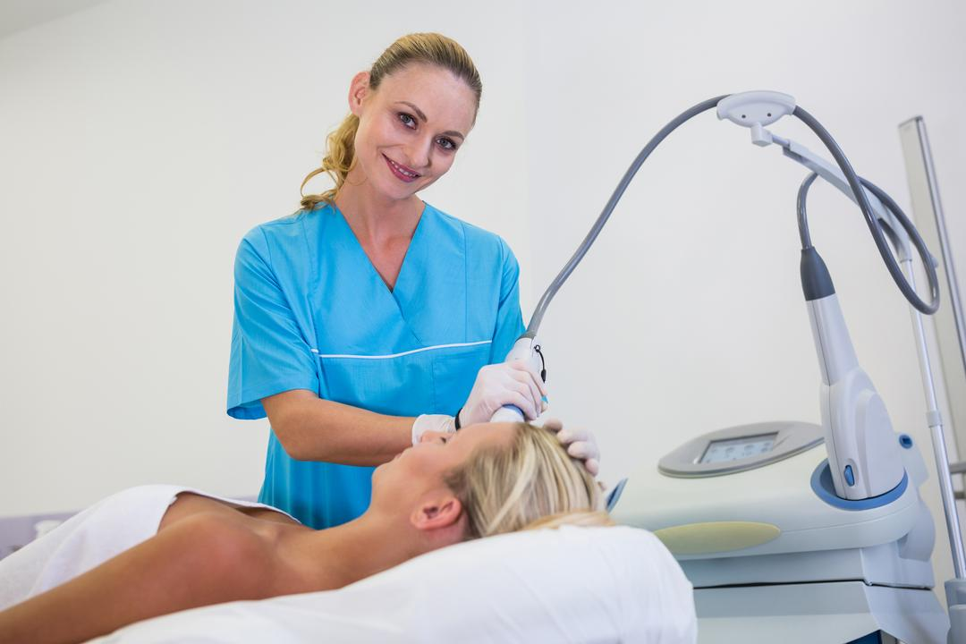 Woman receiving laser epilation treatment on her forehead at beauty salon Free Stock Images from PikWizard