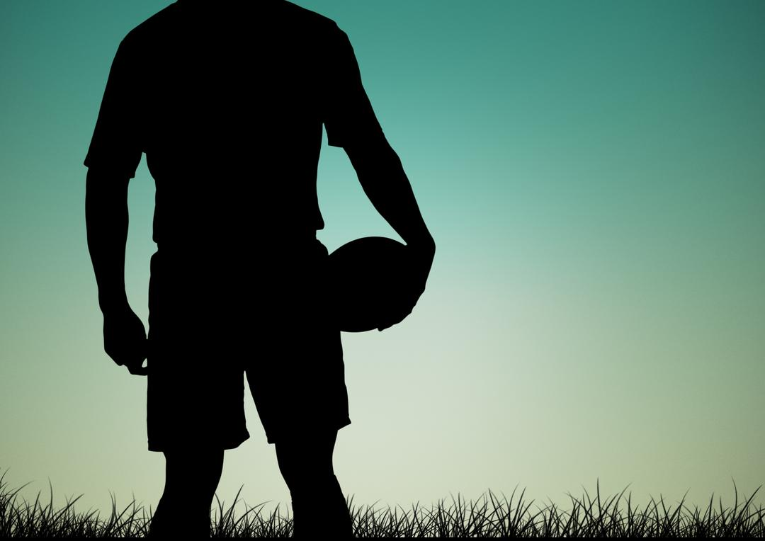 Silhouette of man holding rugby ball