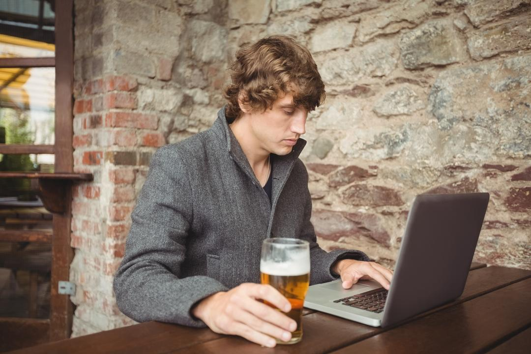 Man using laptop at bar