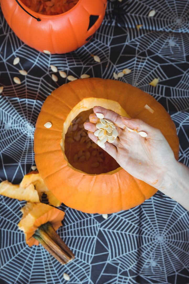 Close-up of woman hand preparing halloween