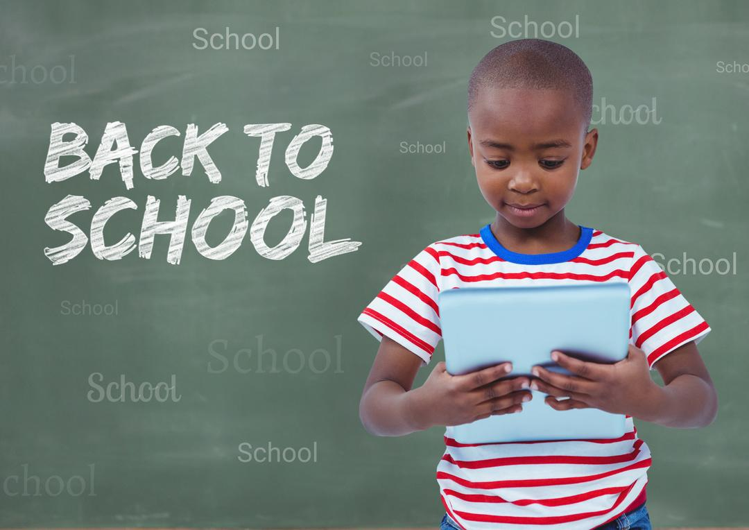 Digital composition of boy holding digital tablet with back to school text in background