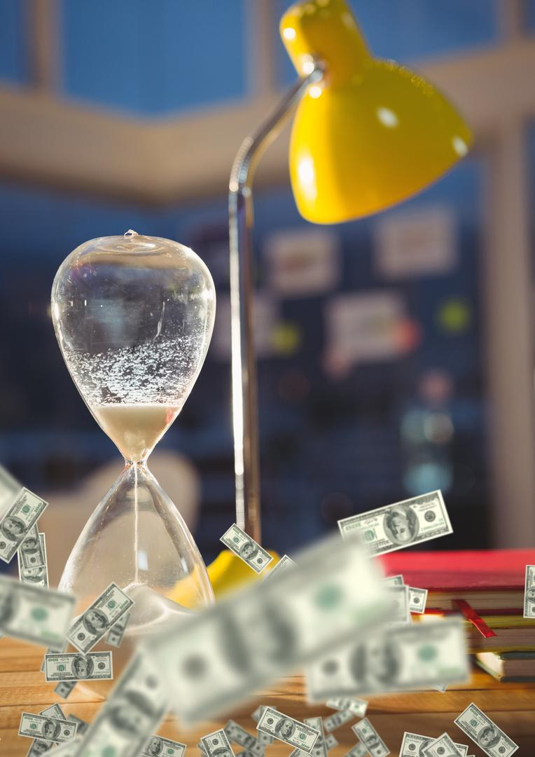 Digital composite of lamp and hourglass with money on desk