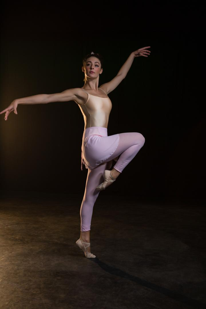Graceful ballerina standing en pointe in the ballet studio Free Stock Images from PikWizard