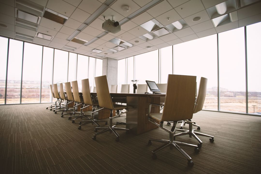 empty conference room interior with chairs and laptop on desk background