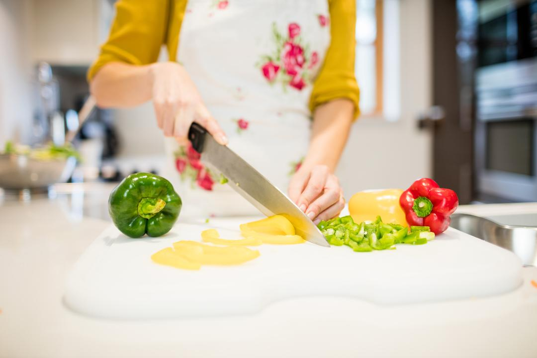 Woman cutting vegetables on chopping board