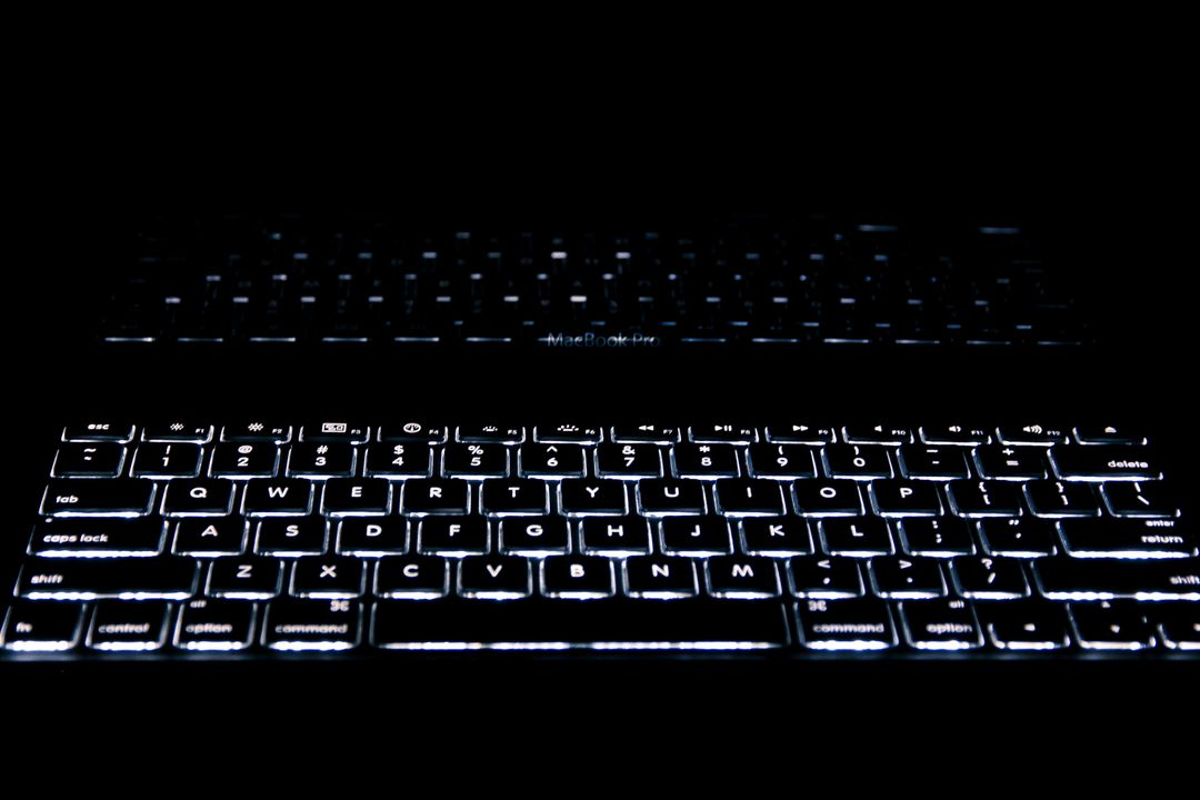 Close-up of Computer Keyboard Against Black Background