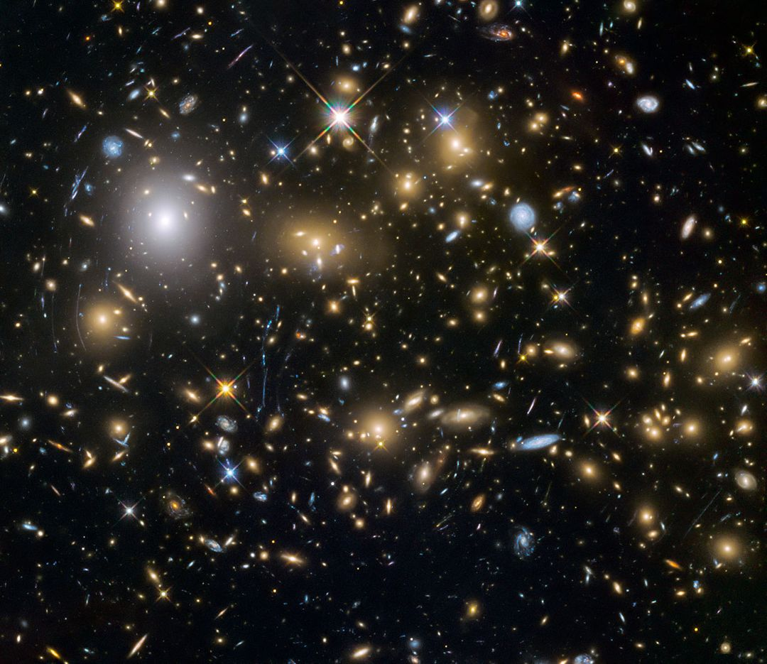 "Observations by the NASA/ESA Hubble Space Telescope have taken advantage of gravitational lensing to reveal the largest sample of the faintest and earliest known galaxies in the universe. Some of these galaxies formed just 600 million years after the big bang and are fainter than any other galaxy yet uncovered by Hubble. The team has determined for the first time with some confidence that these small galaxies were vital to creating the universe that we see today.  An international team of astronomers, led by Hakim Atek of the Ecole Polytechnique Fédérale de Lausanne, Switzerland, has discovered over 250 tiny galaxies that existed only 600-900 million years after the big bang— one of the largest samples of dwarf galaxies yet to be discovered at these epochs. The light from these galaxies took over 12 billion years to reach the telescope, allowing the astronomers to look back in time when the universe was still very young.  Read more: <a href=""http://www.nasa.gov/feature/goddard/hubble-spies-big-bang-frontiers"" rel=""nofollow"">www.nasa.gov/feature/goddard/hubble-spies-big-bang-frontiers</a>  Credit: NASA/ESA  <b><a href=""http://www.nasa.gov/audience/formedia/features/MP_Photo_Guidelines.html"" rel=""nofollow"">NASA image use policy.</a></b>  <b><a href=""http://www.nasa.gov/centers/goddard/home/index.html"" rel=""nofollow"">NASA Goddard Space Flight Center</a></b> enables NASA's mission through four scientific endeavors: Earth Science, Heliophysics, Solar System Exploration, and Astrophysics. Goddard plays a leading role in NASA's accomplishments by contributing compelling scientific knowledge to advance the Agency's mission.  <b>Follow us on <a href=""http://twitter.com/NASAGoddardPix"" rel=""nofollow"">Twitter</a></b>  <b>Like us on <a href=""http://www.facebook.com/pages/Greenbelt-MD/NASA-Goddard/395013845897?ref=tsd"" rel=""nofollow"">Facebook</a></b>  <b>Find us on <a href=""http://instagrid.me/nasagoddard/?vm=grid"" rel=""nofollow"">Instagram</a></b>"