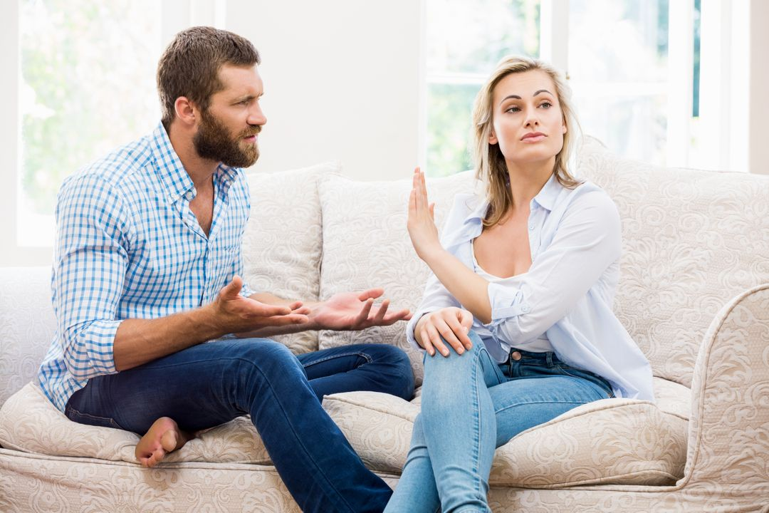 Upset couple arguing with each other at home