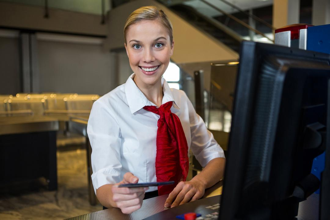 Portrait of smiling female staff at the airport terminal