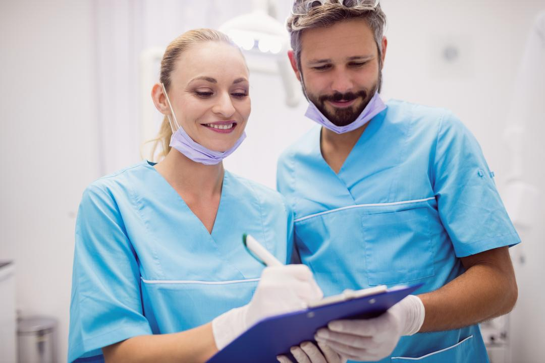 Dentists interacting with each other at dental clinic
