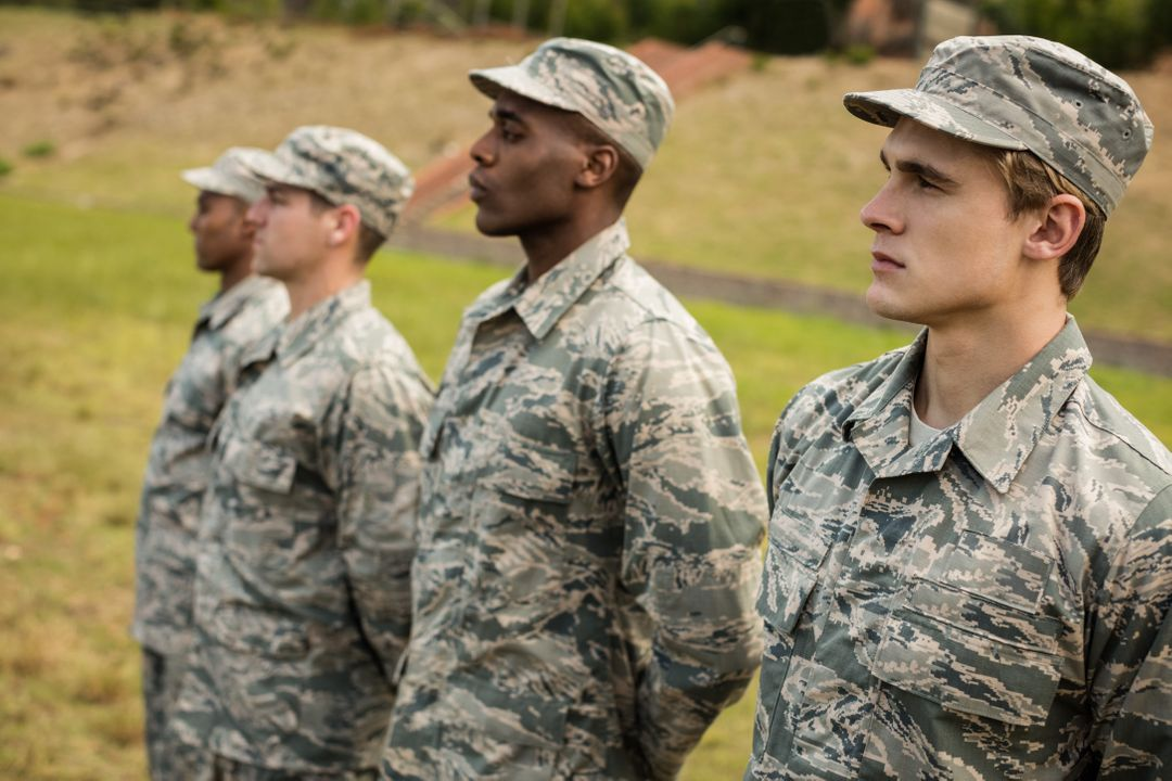 Group of military soldiers standing in line at boot camp Free Stock Images from PikWizard