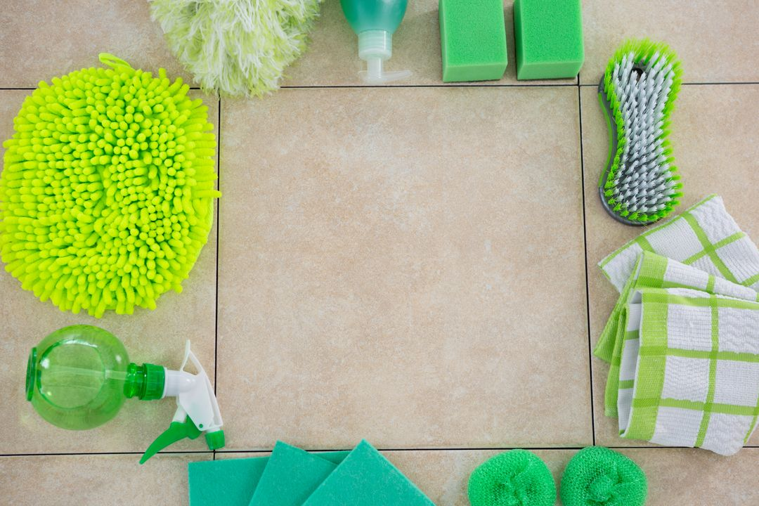 Overhead view of green cleaning products arranged on tiled floor Free Stock Images from PikWizard