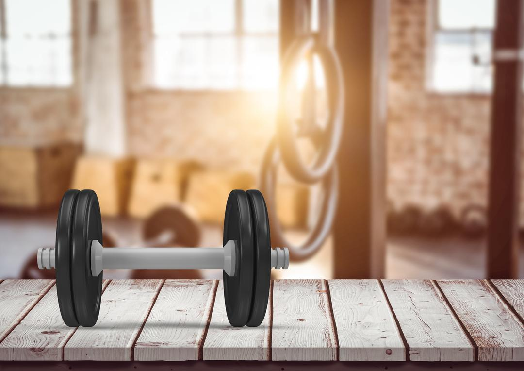 Close-up of dumbbell on a wooden plank in the gym Free Stock Images from PikWizard