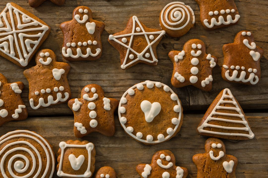 Overhead view of various ginger bread cookies on wooden table Free Stock Images from PikWizard