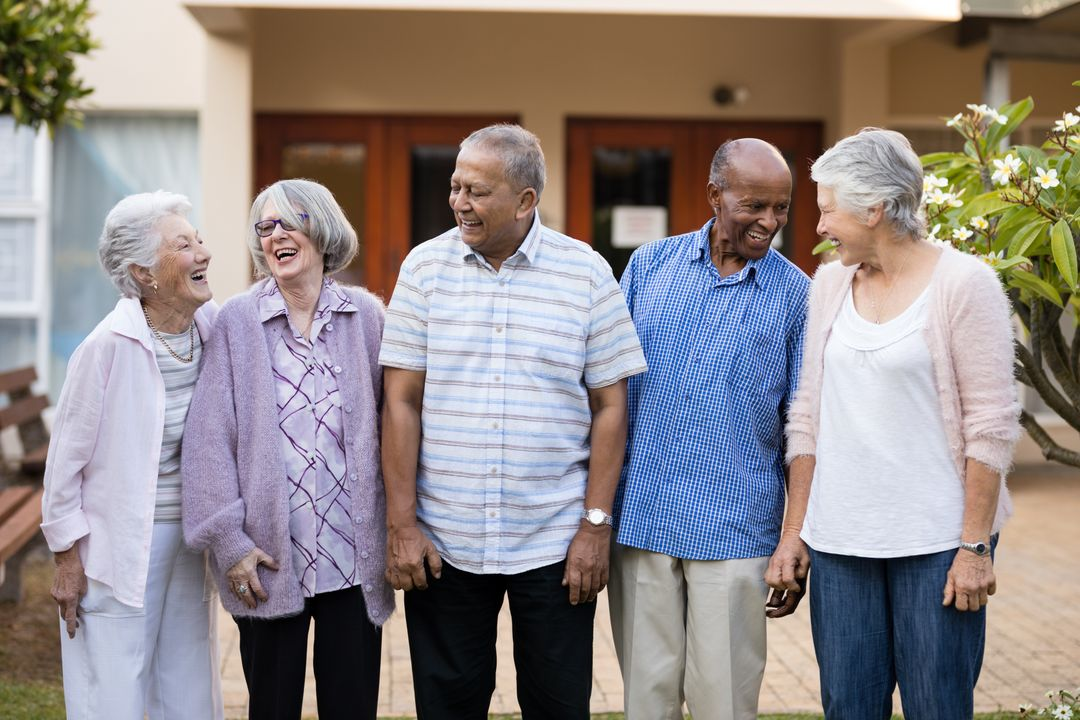 Cheerful senior men and women standing at retirement nursing home Free Stock Images from PikWizard