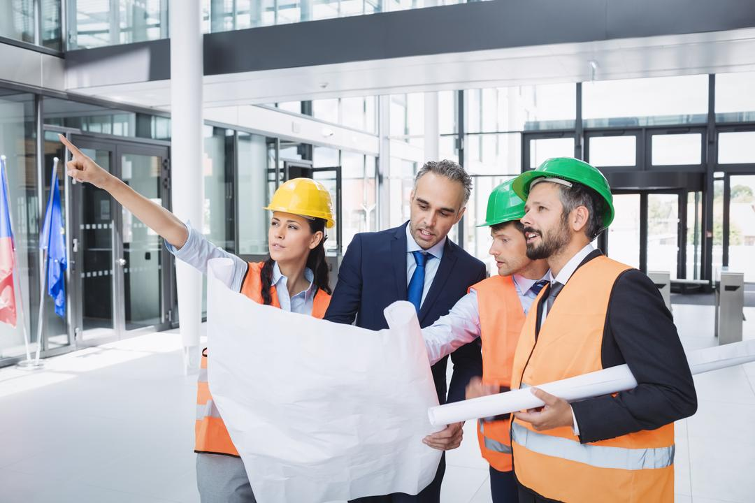 Businessman discussing on blueprint with architects in office building