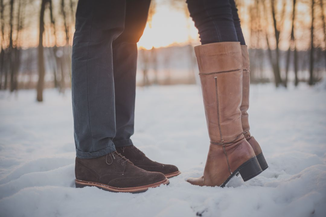 Photo of fashion blogger modeling new shoes in snow