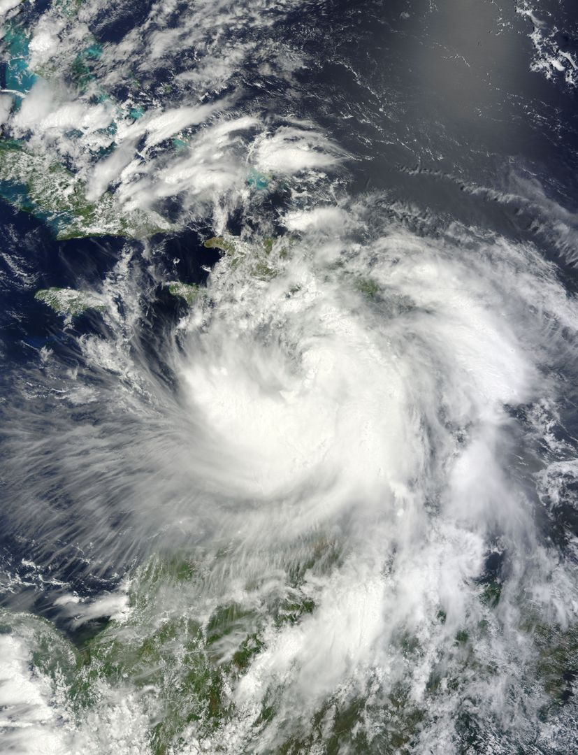 "NASA's Terra satellite passed over Tropical Storm Isaac on Aug. 24 at 15:20 UTC (11:20 a.m. EDT) as it continued moving through the eastern Caribbean Sea. The MODIS instrument onboard Aqua captured this visible image.   At 2 p.m. EDT on Aug. 24, Isaac's maximum sustained winds were near 60 mph (95 kmh). The National Hurricane Center noted that Isaac could strengthen later before reaching the coast of Hispaniola tonight, Aug. 24. Hispaniola is an island that contains the Dominican Republic and Haiti. Isaac is located about 135 miles (215 km) south-southeast of Port au Prince, Haiti, near latitude 16.8 north and longitude 71.4 west. Isaac is now moving toward the northwest near 14 mph (22 kmh).  Isaac is expected to reach hurricane status over the weekend of Aug. 25-26 and NASA satellites will continue providing valuable temperature, rainfall, visible and infrared data.  Text Credit: Rob Gutro NASA's Goddard Space Flight Center, Greenbelt, Md.  <b>To read more go to: <a href=""http://www.nasa.gov/mission_pages/hurricanes/archives/2012/h2012_Isaac.html"" rel=""nofollow"">www.nasa.gov/mission_pages/hurricanes/archives/2012/h2012...</a></b>  Credit: NASA Goddard MODIS Rapid Response Team  <b><a href=""http://www.nasa.gov/audience/formedia/features/MP_Photo_Guidelines.html"" rel=""nofollow"">NASA image use policy.</a></b>  <b><a href=""http://www.nasa.gov/centers/goddard/home/index.html"" rel=""nofollow"">NASA Goddard Space Flight Center</a></b> enables NASA's mission through four scientific endeavors: Earth Science, Heliophysics, Solar System Exploration, and Astrophysics. Goddard plays a leading role in NASA's accomplishments by contributing compelling scientific knowledge to advance the Agency's mission.  <b>Follow us on <a href=""http://twitter.com/NASA_GoddardPix"" rel=""nofollow"">Twitter</a></b>  <b>Like us on <a href=""http://www.facebook.com/pages/Greenbelt-MD/NASA-Goddard/395013845897?ref=tsd"" rel=""nofollow"">Facebook</a></b>  <b>Find us on <a href=""http://instagrid.me/nasagoddard/?vm=grid"" rel=""nofollow"">Instagram</a></b>"