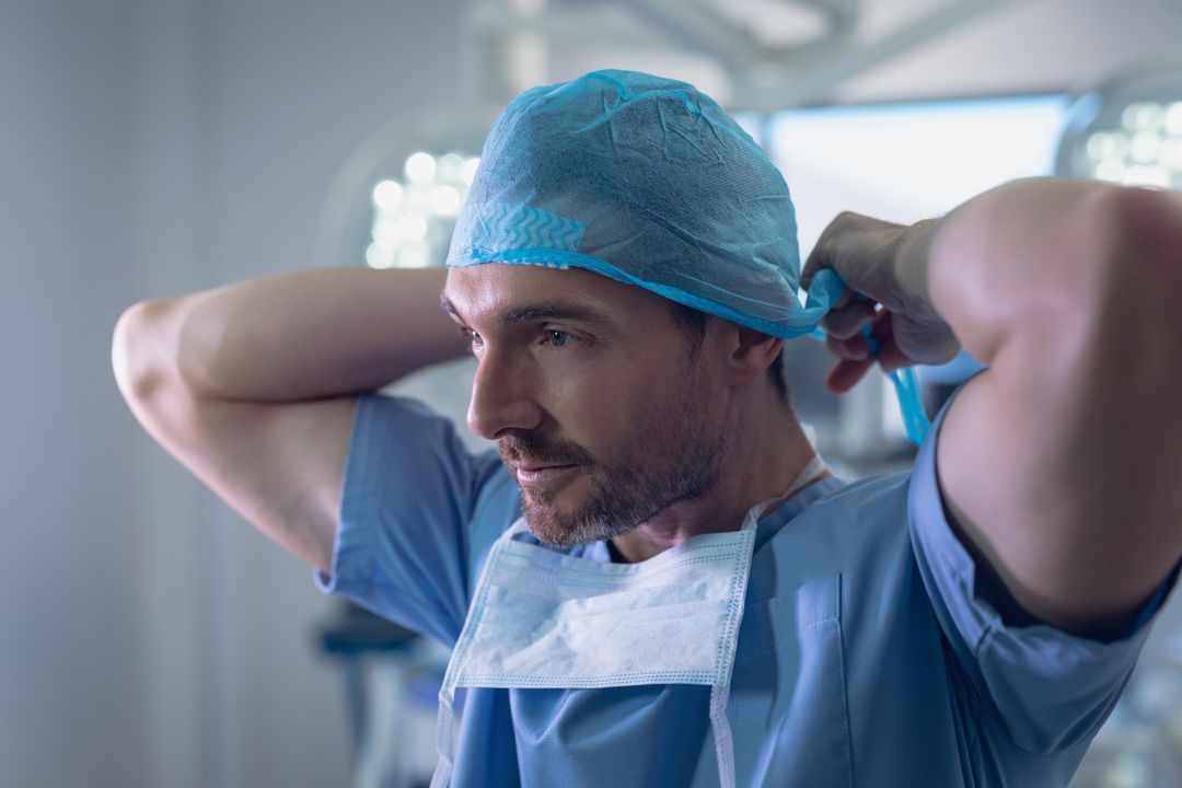 Side view of male surgeon wearing surgical cap in operation room at hospital
